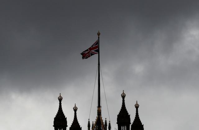 FILE PHOTO: A Union Jack flag flutters over the Houses of Parliament in London, Britain, April 2, 2019. REUTERS/Alkis Konstantinidis/File Photo