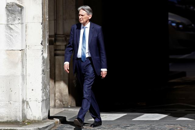 FILE PHOTO: British Chancellor of the Exchequer Philip Hammond walks near the Parliament grounds in London, Britain June 20, 2019. REUTERS/Henry Nicholls/File Photo