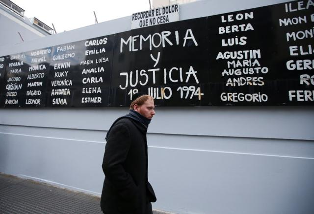 "A banner reading ""Memory and justice"" and with the names of the victims of the 1994 bombing attack on the Argentine Israeli Mutual Association (AMIA) community centre is seen during the 25th anniversary of the attack, in Buenos Aires, Argentina July 18, 2019. REUTERS/Agustin Marcarian"