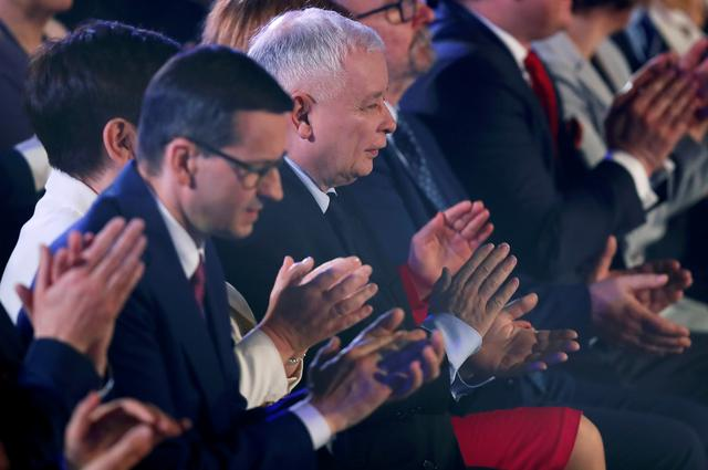 FILE PHOTO: Poland's Law and Justice (PiS) leader Jaroslaw Kaczynski and Poland's Prime Minister Mateusz Morawiecki applaud as they attend a Law and Justice (PiS) party convention ahead of the EU election, in Krakow, Poland May 19, 2019. REUTERS/Kacper Pempel/File Photo