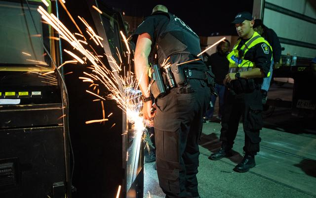 York Regional Police cut the locks on gambling machines seized during raids in an illegal gaming investigation named Project Sindacato in Vaughan, Ontario, Canada  July 16, 2019. York Regional Police/Handout via REUTERS