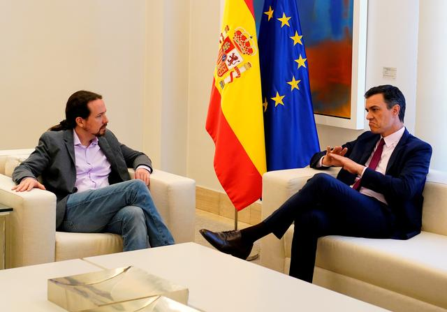 FILE PHOTO: Spain's acting Prime Minister Pedro Sanchez speaks with Unidas Podemos' (Together We Can) leader Pablo Iglesias during their meeting at the Moncloa Palace in Madrid, Spain, May 7, 2019. REUTERS/Juan Medina/File Photo
