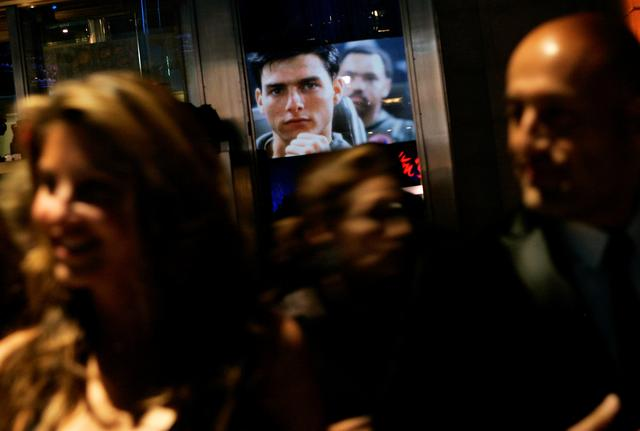 """FILE PHOTO: An image of Tom Cruise from the movie """"Top Gun"""" is reflected in a window as people arrive at the Museum of the Moving Image Salute to Tom Cruise in New York November 6, 2007.  REUTERS/Shannon Stapleton/"""