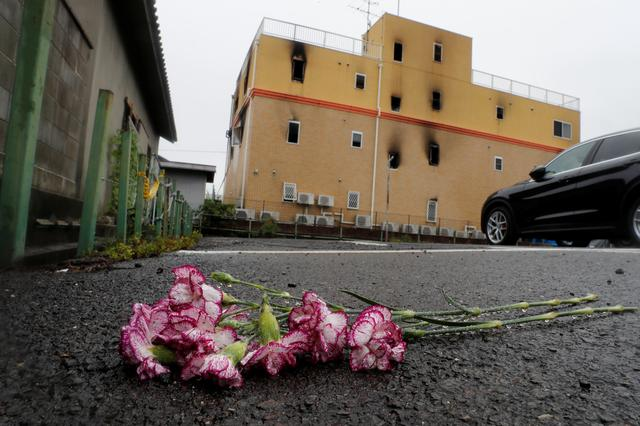 Flowers are placed in front of the torced Kyoto Animation building in respect for the victims, in Kyoto, Japan, July 19, 2019. REUTERS/Kim Kyung-Hoon