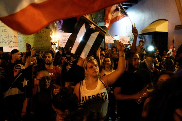 Demonstrators chant, sing, and wave Puerto Rican flags during the sixth day of protest calling for the resignation of Governor Ricardo Rossello in San Juan, Puerto Rico July 18, 2019.  REUTERS/Gabriella N. Baez
