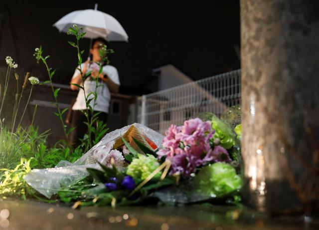 Flowers are placed near the Kyoto Animation building which was torched by arson attack in Kyoto, Japan, July 18, 2019.  REUTERS/Kim Kyung-Hoon
