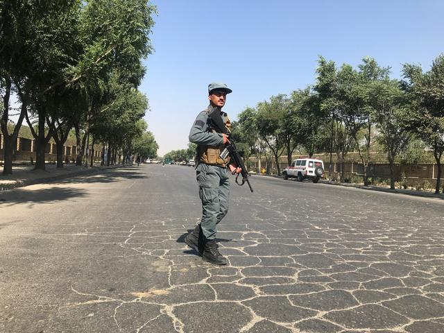 An Afghan policeman keeps watch at the site of a blast near Kabul University in Kabul, Afghanistan July 19, 2019. REUTERS/Omar Sobhani