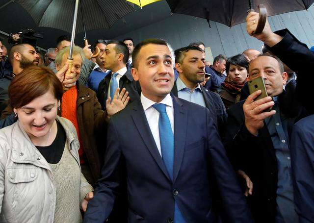FILE PHOTO: Italian Deputy Prime Minister and 5-Star Movement leader Luigi Di Maio leaves after casting his vote in the European election in Pomigliano d'Arco, Italy May 26, 2019. REUTERS/Ciro de Luca/File Photo