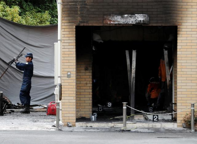 Firefighters conduct an investigation at the Kyoto Animation building which was torched by arson attack, in Kyoto, Japan, July 19, 2019. REUTERS/Kim Kyung-Hoon