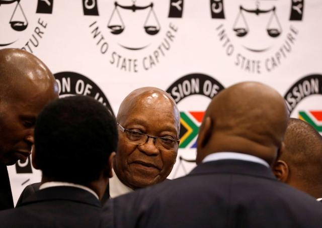 Former South African President Jacob Zuma talks with members of his legal team during a break in proceedings at the Commission of Inquiry into State Capture in Johannesburg, South Africa, July 19, 2019. REUTERS/Mike Hutchings