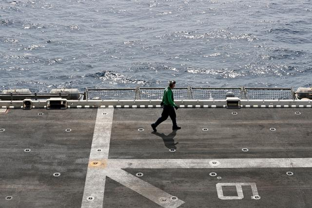 FILE PHOTO: A U.S. sailor walks on the flight deck of USS Boxer (LHD-4) in the Arabian Sea off Oman July 16, 2019. Picture taken July 16, 2019. REUTERS/Ahmed Jadallah