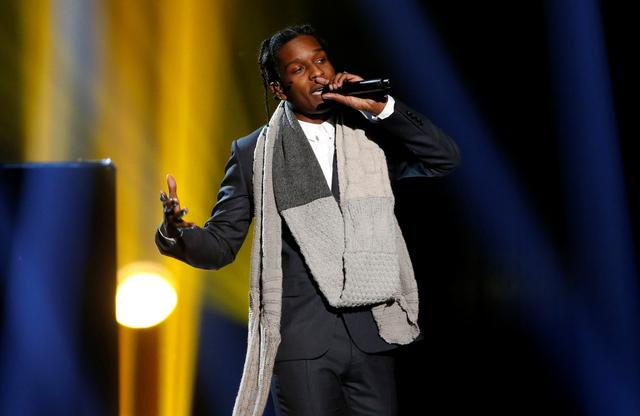 """FILE PHOTO: A$AP Rocky performs """"I'm Not the Only One"""" with Sam Smith (not pictured) during the 42nd American Music Awards in Los Angeles, California November 23, 2014.   REUTERS/Mario Anzuoni/File Photo"""