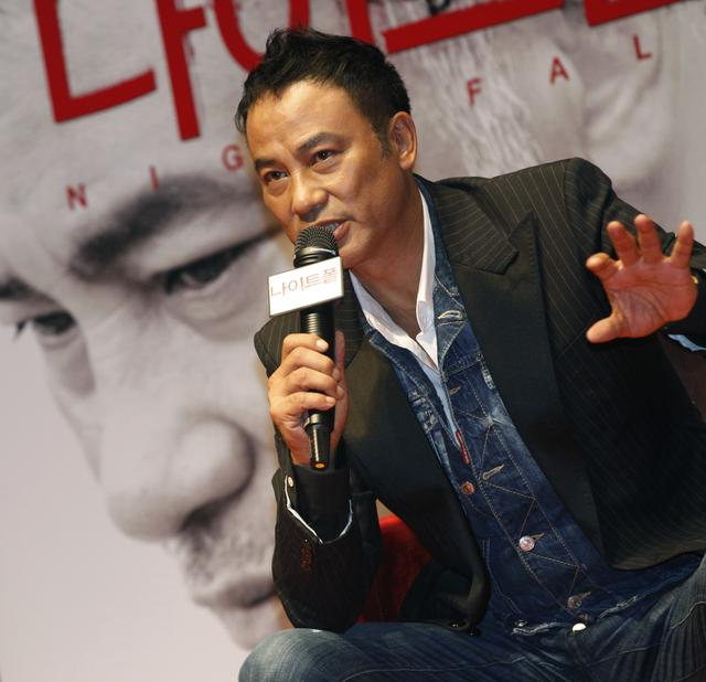 "FILE PHOTO: Hong Kong actor Simon Yam speaks during a news conference to promote his movie ""Nightfall"" in Seoul September 12, 2012.   REUTERS/Lee Jae-Won"