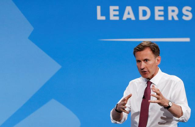 FILE PHOTO: Jeremy Hunt, a leadership candidate for Britain's Conservative Party, gestures as he attends a hustings event in London, Britain July 17, 2019. REUTERS/Peter Nicholls