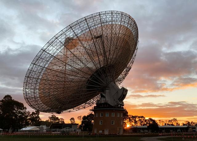The radio telescope at the Parkes Observatory is pictured at sunset near the town of Parkes, Australia July 15, 2019.  REUTERS/Stefica Nicol Bikes