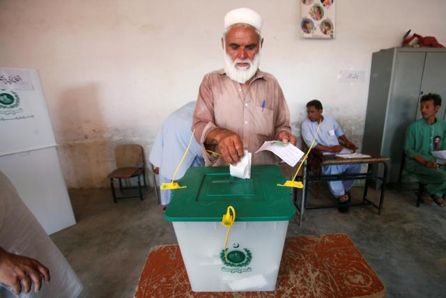 A voter casts his vote at a polling station during the first provincial elections in Jamrud, Pakistan July 20, 2019. REUTERS/Stringer