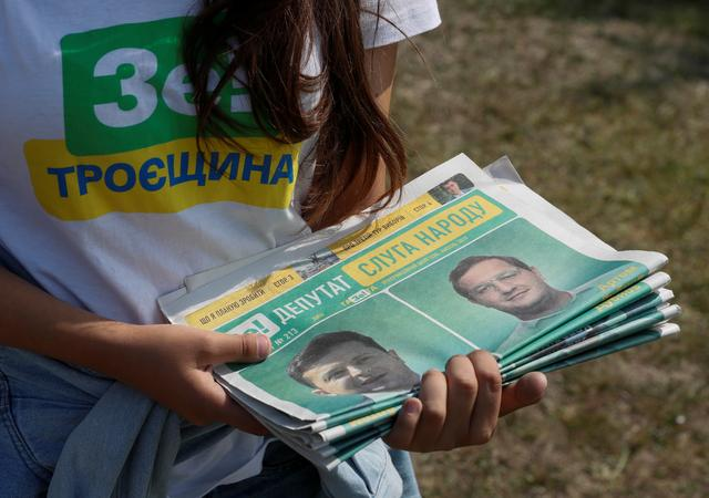 FILE PHOTO: A volunteer holds electoral materials in support of the Servant of the People party led by Ukrainian President Volodymyr Zelenskiy during an event ahead of the parliamentary election in Kiev, Ukraine July 18, 2019. REUTERS/Valentyn Ogirenko