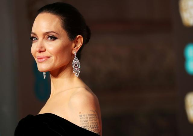 FILE PHOTO: Angelina Jolie arrives at the British Academy of Film and Television Awards (BAFTA) at the Royal Albert Hall in London, Britain, February 18, 2018. REUTERS/Hannah McKay