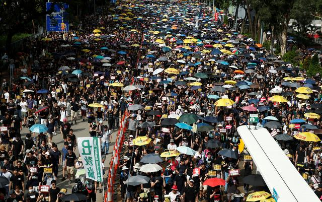 Anti-extradition demonstrators march to call for democratic reforms, in Hong Kong, China July 21, 2019. REUTERS/Edgar Su