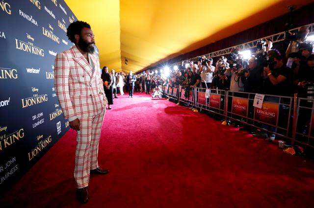 """FILE PHOTO: Cast member Donald Glover poses as he arrives for the World Premiere of """"The Lion King"""" in Los Angeles, California, U.S., July 9, 2019. REUTERS/Mario Anzuoni/File Photo"""