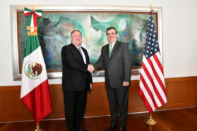 U.S Secretary of State Mike Pompeo shakes hands with Mexican Foreign Minister Marcelo Ebrard during a private meeting at the Foreign Ministry Building (SRE), in Mexico City, Mexico July 21, 2019. Mexico's Foreign Ministry /Handout via REUTERS