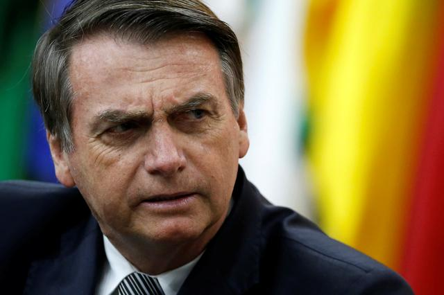 FILE PHOTO: Brazil's President Jair Bolsonaro looks on during a National Soccer Day Cerenomy in Brasilia, Brazil July 19, 2019. REUTERS/Adriano Machado