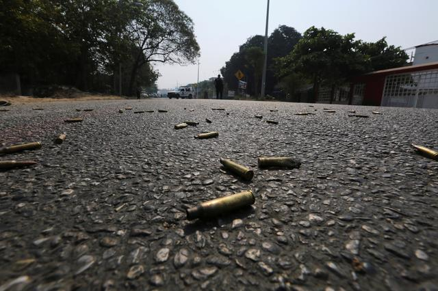 FILE PHOTO: Bullet casings lie on the street near a crime scene in Acapulco, Mexico May 7, 2019. REUTERS/Javier Verdin /File Photo