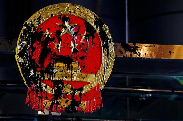 A National Emblem splashed with paint after anti-extradition bill protest is seen outside Chinese Liaison Office in Hong Kong, China July 21, 2019. REUTERS/Tyrone Siu
