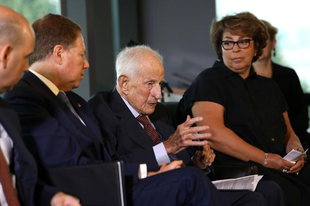 FILE PHOTO: Sylvie Sulitzer (R) listens as former U.S. Attorney Robert Morris Morgenthau (C) speaks during a ceremony to return the painting Deux Femmes Dans Un Jardin by Pierre Auguste Renoir, stolen by the Nazis in World War II from Ms. Sulitzer's family, at the Jewish Heritage Museum in New York City, New York, U.S., September 12, 2018. REUTERS/Mike Segar/File Photo