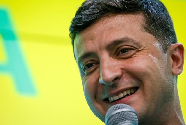 Ukraine's President Volodymyr Zelenskiy speaks at his party's headquarters after a parliamentary election in Kiev, Ukraine July 21, 2019. REUTERS/Valentyn Ogirenko