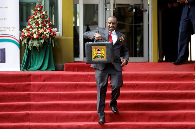 FILE PHOTO: Kenya's Cabinet Secretary of National Treasury (Finance Minister) Henry Rotich holds up a briefcase containing the Government Budget for the 2019/20 fiscal year in Nairobi, Kenya June 13, 2019. REUTERS/Baz Ratner/File Photo