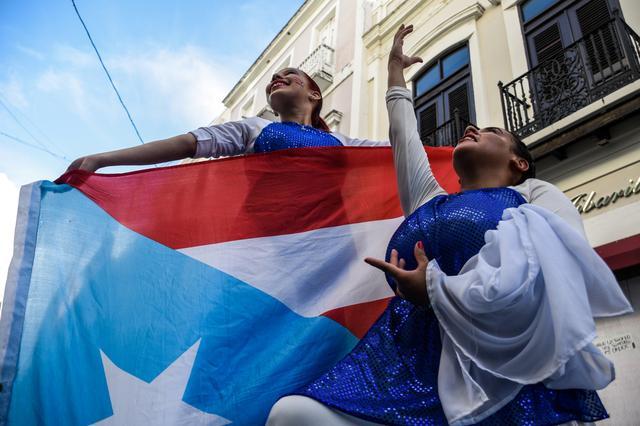 Demonstrators protest for the resignation of Puerto Rico's governor Ricardo Rossello in San Juan, Puerto Rico, July 21, 2019.  REUTERS/Gabriella N. Baez