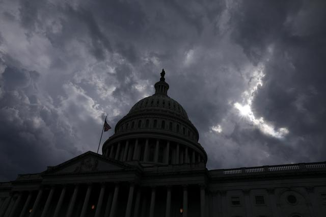Storm clouds pass over the U.S. Capitol dome in Washington, U.S. June 17, 2019. REUTERS/Jonathan Ernst
