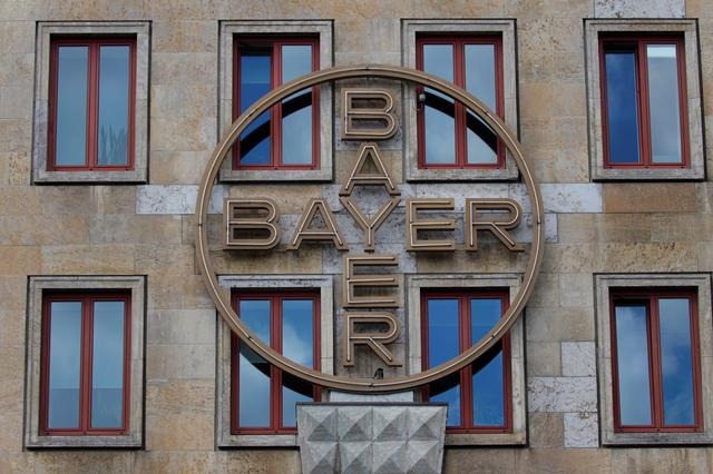 FILE PHOTO: The logo of Bayer AG is pictured at the facade of the historic headquarters of the German pharmaceutical and chemical maker in Leverkusen, Germany, May 14, 2019. REUTERS/Wolfgang Rattay