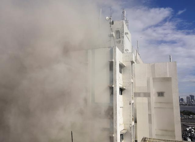 Smoke is seen coming out of a Mahanagar Telephone Nigam Limited (MTNL) building after a fire broke out, in Mumbai, India July 22, 2019. REUTERS/Francis Mascarenhas