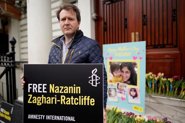 FILE PHOTO: Richard Ratcliffe, husband of British-Iranian dual national Nazanin Zaghari-Ratcliffe, poses for a photograph after delivering a Mother's Day card and flowers to the Iranian Embassy in London, Britain March 31, 2019. REUTERS/Simon Dawson/File Photo