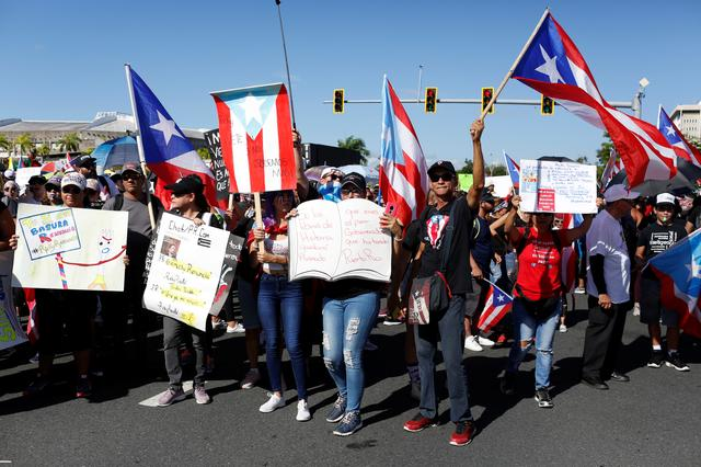 People chant slogans as they wave Puerto Rican flags during ongoing protests calling for the resignation of Governor Ricardo Rossello in San Juan, Puerto Rico July 22, 2019. REUTERS/Marco Bello