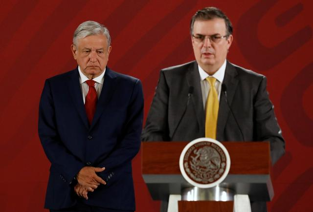 Mexico's President Andres Manuel Lopez Obrador and Mexico's Foreign Minister Marcelo Ebrard  attend a news conference at the National Palace in Mexico City, Mexico July 22, 2019. REUTERS/Edgard Garrido