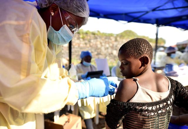FILE PHOTO: A Congolese health worker administers Ebola vaccine to a child at the Himbi Health Centre in Goma, Democratic Republic of Congo, July 17, 2019. REUTERS/Olivia Acland