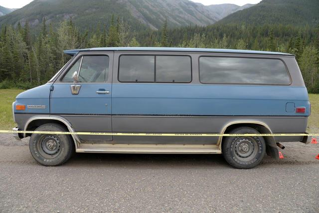 A blue 1986 Chevrolet van bearing Alberta licence plates is seen in an undated photo provided by the Royal Canadian Mounted Police (RCMP) at the site of a double homicide where Chynna Noelle Deese, 24, of the United States and Lucas Robertson Fowler, 23 of Australia were found dead near Liard Hot Springs, British Columbia, Canada. RCMP/Handout via REUTERS