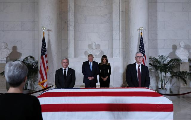 U.S. President Donald Trump and first lady Melania Trump pay their respects at the casket of former Supreme Court Justice John Paul Stevens, who died last week at age 99, as Stevens lies in repose at the U.S. Supreme Court in Washington, U.S., July 22, 2019. REUTERS/Jonathan Ernst