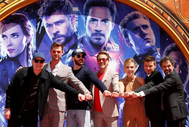 FILE PHOTO: Actors Robert Downey Jr., Chris Evans, Mark Ruffalo, Chris Hemsworth, Scarlett Johansson, Jeremy Renner and Marvel Studios President Kevin Feige pose for a photo at the handprint ceremony at the TCL Chinese Theatre in Hollywood, Los Angeles, California, U.S. April 23, 2019. REUTERS/Mario Anzuoni