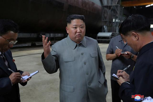 North Korean leader Kim Jong Un visits a submarine factory in an undisclosed location, North Korea, in this undated picture released by North Korea's Central News Agency (KCNA) on July 23, 2019.    KCNA via REUTERS