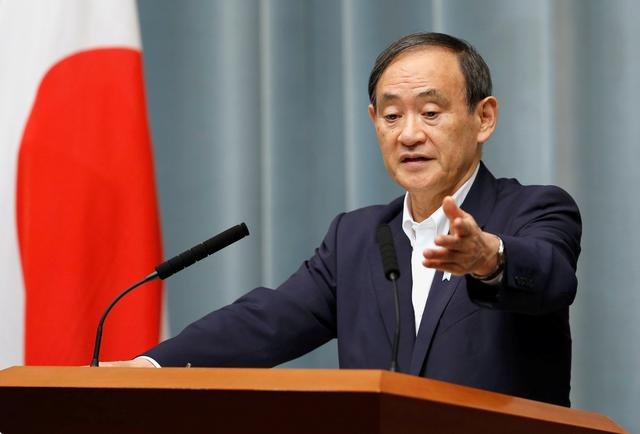 FILE PHOTO: Japan's Chief Cabinet Secretary Yoshihide Suga attends a news conference at Prime Minister Shinzo Abe's official residence in Tokyo, Japan May 29, 2017.   REUTERS/Toru Hanai/File Photo