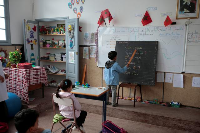 FILE PHOTO: A student reads French words during a class in the Oudaya primary school in Rabat, Morocco January 31, 2019. REUTERS/Youssef Boudlal/File Photo