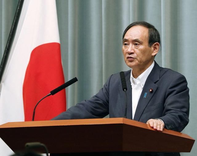 FILE PHOTO: Japan's Chief Cabinet Secretary Yoshihide Suga speaks at a news conference about North Korea's missile launch in Tokyo, Japan in this photo taken by Kyodo on September 15, 2017.  Kyodo/via REUTERS/File Photo