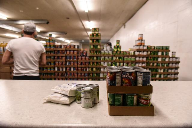 FILE PHOTO: A worker places packaged food onto a counter inside of a food distribution center on the Cheyenne River Indian Reservation in Eagle Butte, South Dakota, U.S. January 25, 2019. REUTERS/Stephanie Keith/File Photo