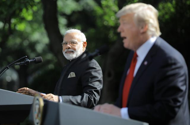 FILE PHOTO: U.S. President Donald Trump (R) holds a joint news conference with Indian Prime Minister Narendra Modi in the Rose Garden of the White House in Washington, U.S., June 26, 2017. REUTERS/Carlos Barria/File Photo
