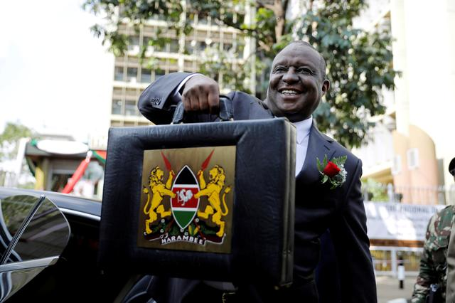 FILE PHOTO: Kenya's Cabinet Secretary for National Treasury (Finance Minister) Henry Rotich holds up a briefcase containing the Government Budget for the 2019/20 fiscal year in Nairobi, Kenya, June 13, 2019. REUTERS/Baz Ratner/File Photo