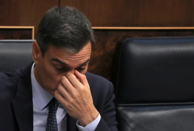 Spain's acting Prime Minister Pedro Sanchez reacts during the second day of the investiture debate at the Parliament in Madrid, Spain, July 23, 2019. REUTERS/Sergio Perez